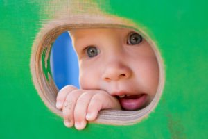 Baby looking through hole